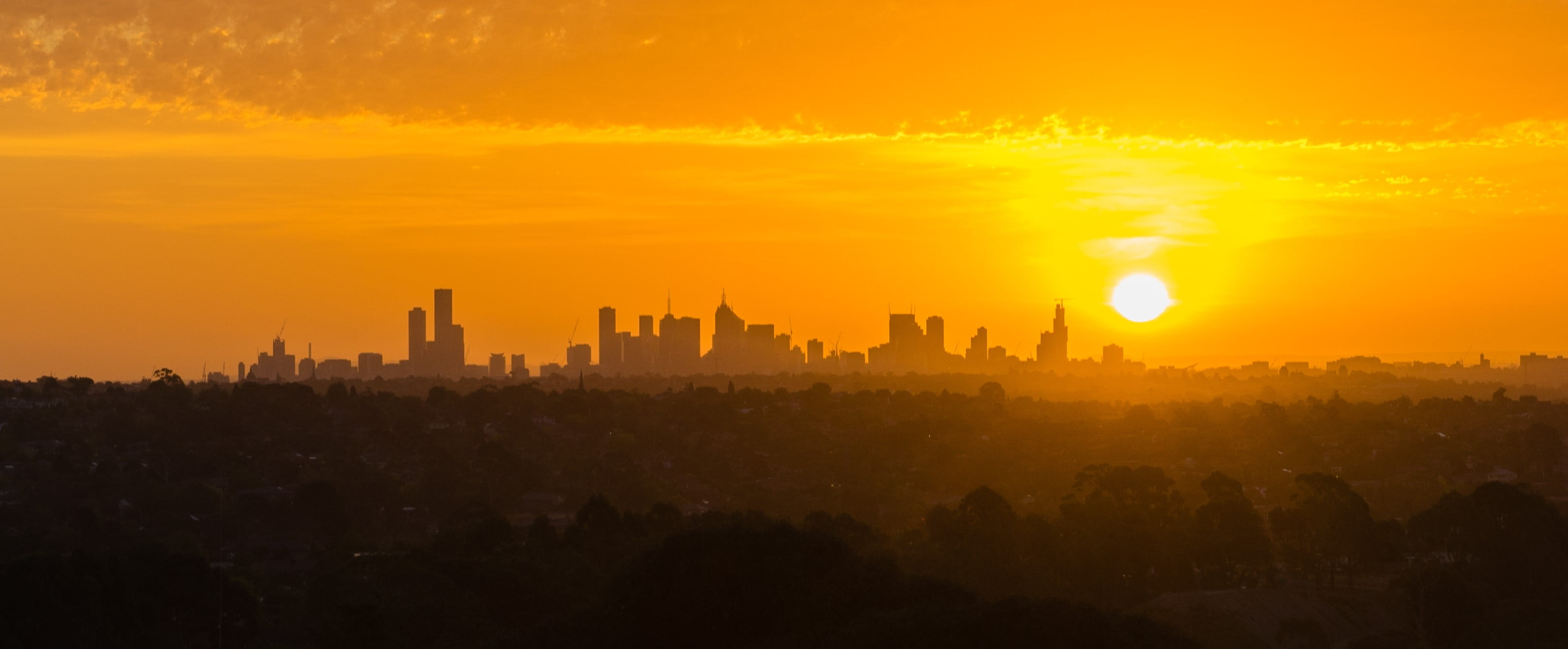 View of Melbourne cityscape at beautiful orange sunset